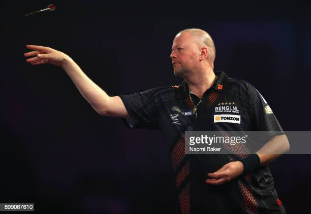 Raymond van Barneveld of the Netherlands in action during his third round match against Vincent van der Voort of the Netherlands on day eleven of the...