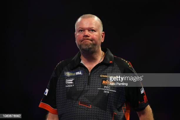 Raymond van Barneveld of the Netherlands looks dejected following defear during his first round match against Darius Labanauskas of Lithuania during...