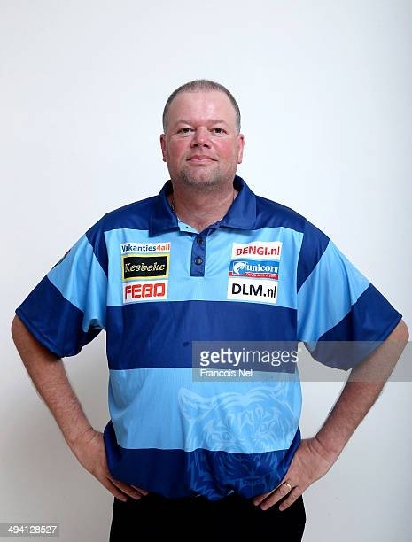Raymond Van Barneveld of the Netherlands poses for a portrait prior to the start of the draw ceremony for the Dubai Duty Free Darts Masters to reveal...