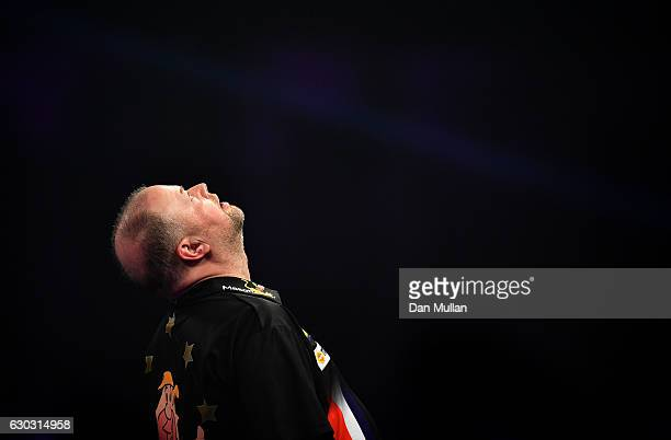 Raymond van Barneveld of the Netherlands reacts after defeating Robbie Green of Great Britain during the first round match on day six of the 2017...