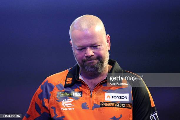 Raymond van Barneveld of The Netherlands reacts as he walks off the stage after loosing his First Round match against Darin Young of The United...