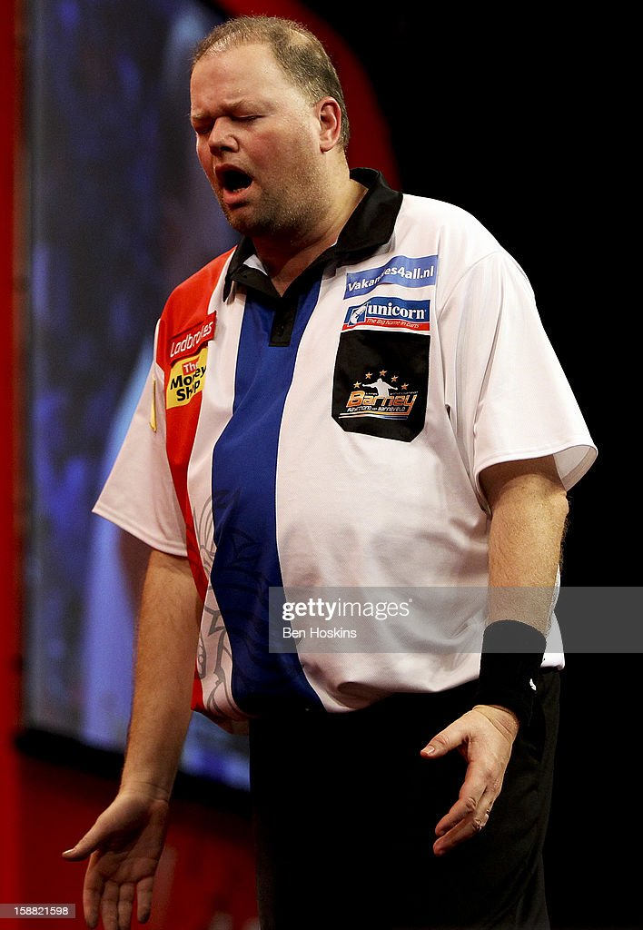 Raymond van Barneveld of the Netherlands reacts during his semi final match against Phil Taylor of England on day fourteen of the 2013 Ladbrokes.com World Darts Championship at the Alexandra Palace on December 30, 2012 in London, England.