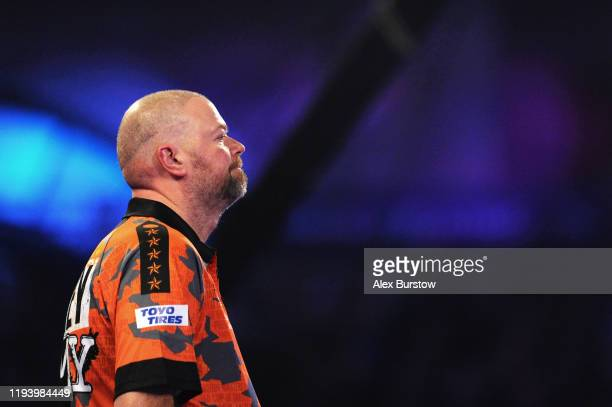 Raymond van Barneveld of The Netherlands reacts in his First Round match against Darin Young of The United States during Day Two of the 2020 William...