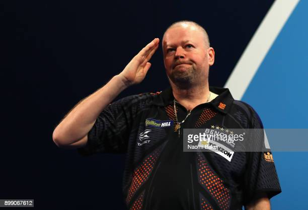 Raymond van Barneveld of the Netherlands salutes to the crowd prior to his third round match against Vincent van der Voort of the Netherlands on day...