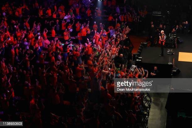 Raymond van Barneveld of the Netherlands shows some emotions as he speaks to the fans after he competes against Michael van Gerwen of the Netherlands...