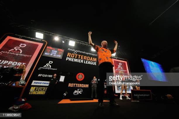 Raymond van Barneveld of the Netherlands shows some emotions before he competes against Michael van Gerwen of the Netherlands during day two of the...