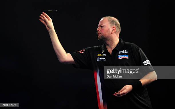 Raymond van Barneveld of the Netherlands throws during his quarter final match against Michael Smith of England during Day Thirteen of the 2016...