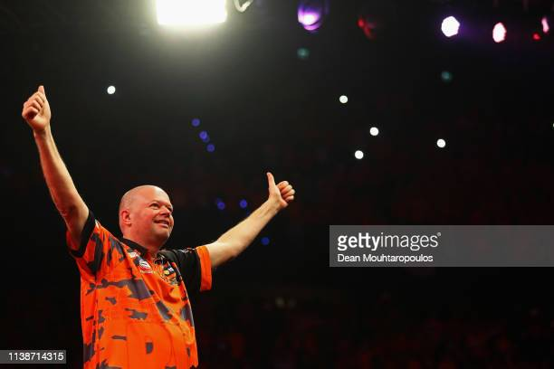 Raymond van Barneveld of the Netherlands walks out to compete against Daryl Gurney of Northern Ireland during day one of the 2019 Unibet Premier...