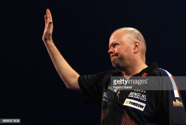 Raymond van Barneveld of the Netherlands waves to the crowd prior to his third round match against Vincent van der Voort of the Netherlands on day...