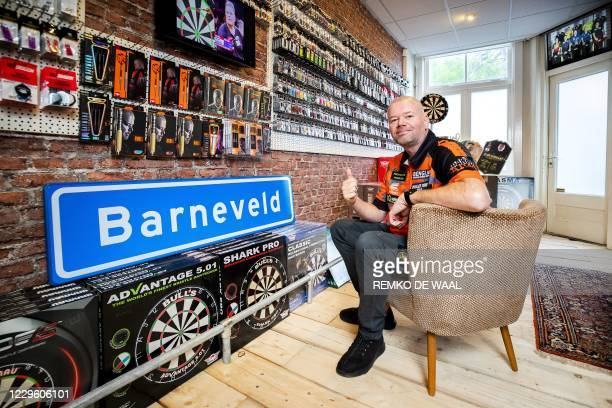 Raymond van Barneveld poses during the opening of his dart shop Barney's Darts and Trophies on November 13, 2020. - The darter said goodbye to the...