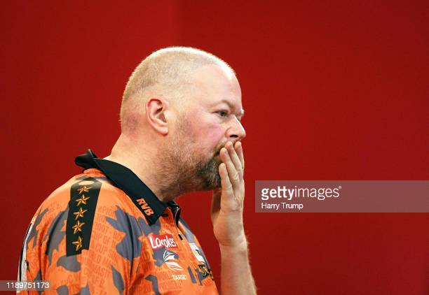 Raymond Van Barneveld reacts during Day Three of the PDC Players Darts Championship at Butlins Resort on November 24 2019 in Minehead England