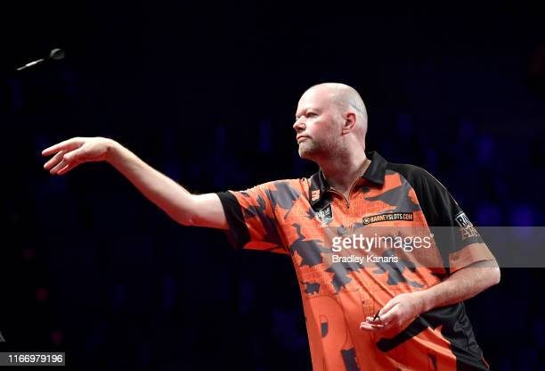 Raymond van Barneveld throws in his first round match against Haupai Puha during the Brisbane Darts Masters at Brisbane Convention Exhibition Centre...