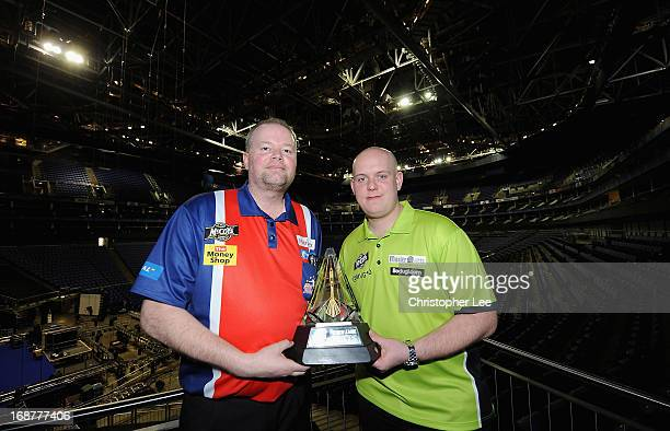 Raymond van Berneveld and Michael van Gerwen pose with the McCoys Premier League Trophy during the McCoy's Premier League Darts PlayOffs Media Launch...