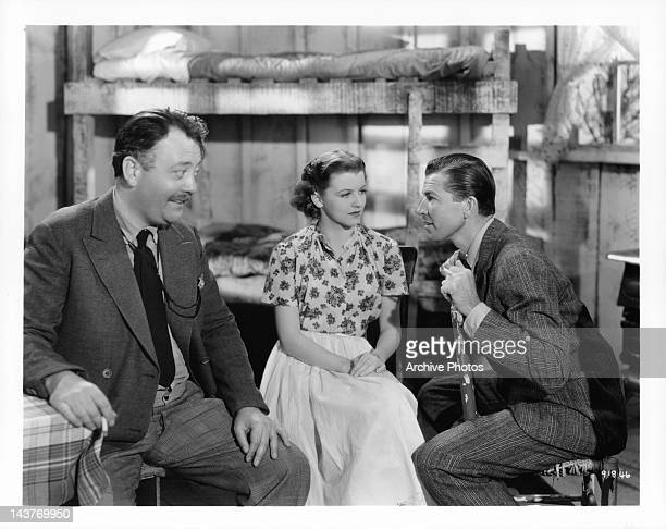 Raymond Walburn and Bruce Cabot having conversation with Betty Furness at their side in a scene from the film 'The Three Wise Guys', 1936.