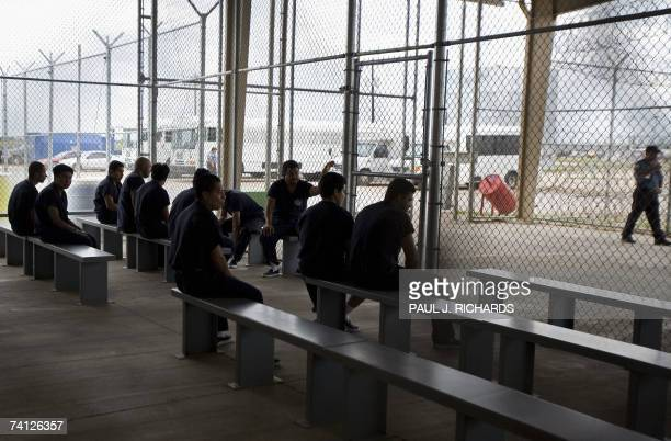 Detainees wait to be processed inside Homeland Security's Willacy Detention Center a facility with 10 giant tents that can house up to 2000 detained...