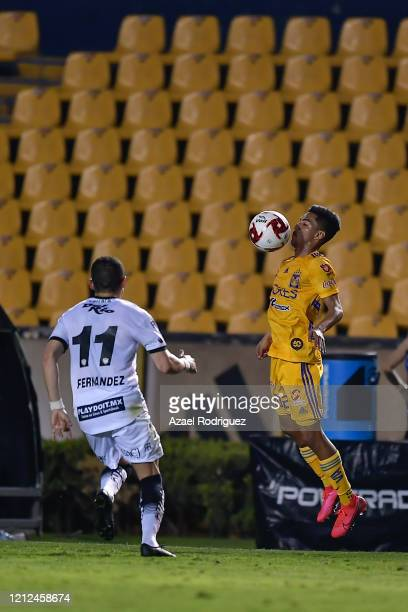 Raymundo Fulgencio of Tigres controls the ball against Mauro Fernández of Juárez during the 10th round match between Tigres UANL and FC Juarez as...