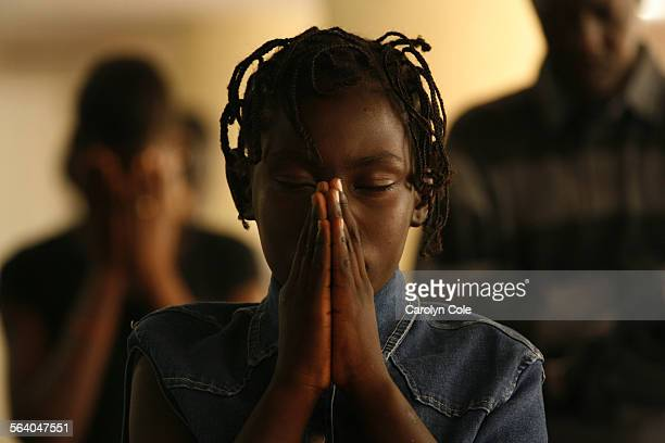 ISRAEL – Rayna age 10 from Southern Sudan prays at a shelter in Israel where more than 150 refugees have been staying South Sudanese refugees living...