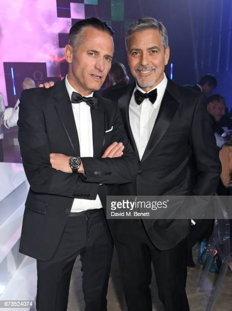 Raynald Aeschlimann and George Clooney attend the OMEGA 'Lost In Space' dinner to celebrate the 60th anniversary of the OMEGA Speedmaster which has...