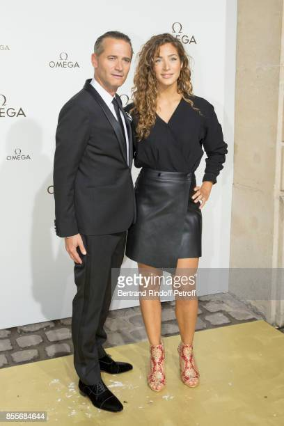 Raynald Aeschlimann and Manon Azem attend 'Her Time' Omega Photocall as part of the Paris Fashion Week Womenswear Spring/Summer 2018 on September 29...