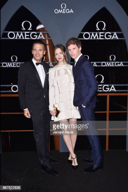 Raynald Aeschlimann Hannah Bagshawe and Eddie Redmayne attend the OMEGA Aqua Terra at Palazzo Pisani Moretta on October 28 2017 in Venice Italy