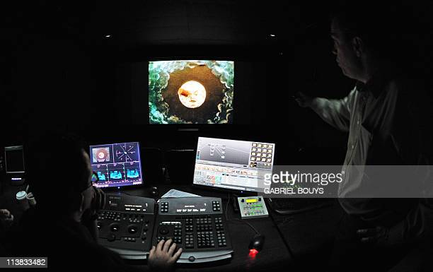 RAYNALDYSerge Bromberg works on April 21 2011 on the restoration of the 1902 movie Le voyage dans la lune by French director Georges Melies This...