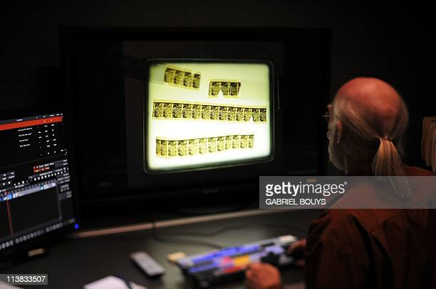 RAYNALDYTom Burton Technicolor's Executive Director of Restoration Services works works on April 21 2011 on the restoration of the 1902 movie Le...
