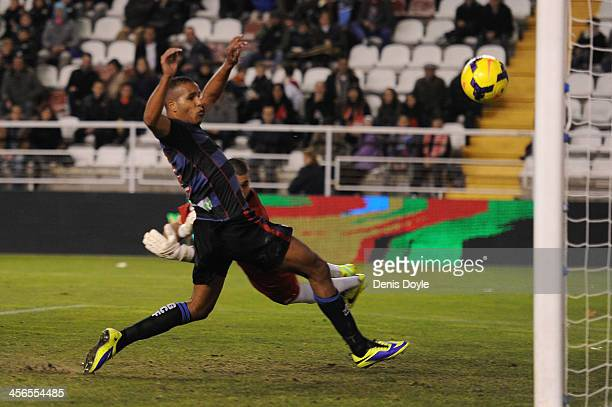 Rayo Vallecano de Madrid goalkeeper Ruben fails to save the opening goal scored by Fran Rico of Granada CF and watched by Youssef ElArabi of Granada...