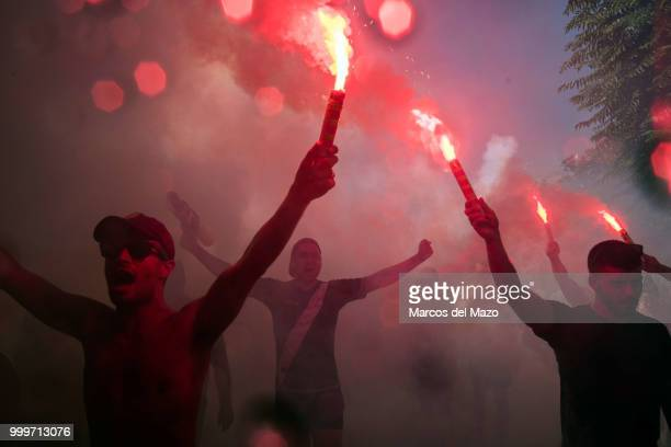 Rayo Vallecano fans shooting with flares during the annual water fight known as Batalla Naval in Vallecas neighborhood where thousands of people...