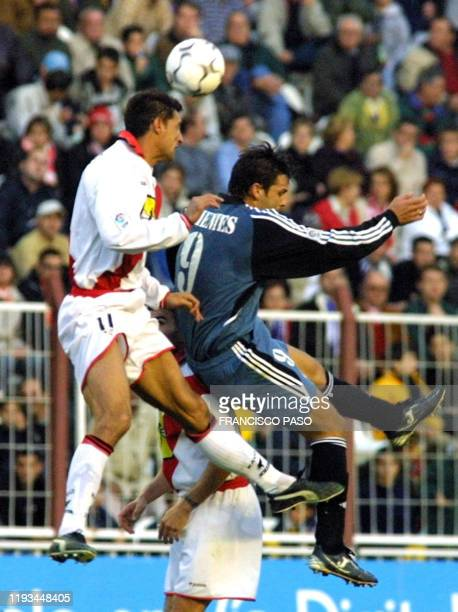 Rayo Vallecano's French player Jean Francois Hernandez battles with Real Madrid player Morientes in Madrid during their Spanish league, football...