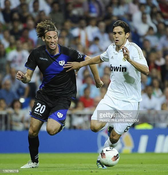 Rayo Vallecano's midfielder Michu vies with Real Madrid's Brazilian midfielder Kaka during their Spanish league football match Real Madrid vs Rayo...