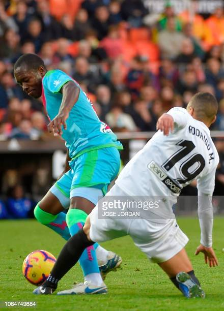 Rayo Vallecano's Peruvian defender Luis Advincula challenges Valencia's Spanish forward Rodrigo Moreno during the Spanish league football match...