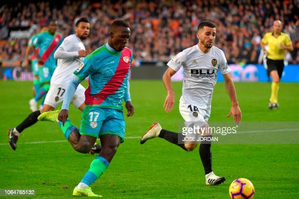 Rayo Vallecano's Peruvian defender Luis Advincula challenges Valencia's Spanish defender Jose Gaya during the Spanish league football match between...