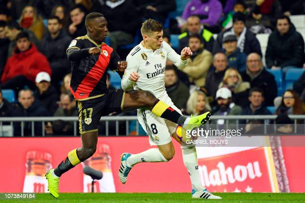 Rayo Vallecano's Peruvian defender Luis Advincula vies with Real Madrid's German midfielder Toni Kroos during the Spanish League football match...
