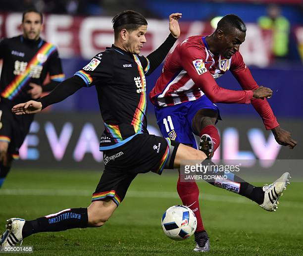 TOPSHOT Rayo Vallecano's Portuguese defender Ze Castro vies with Atletico Madrid's Colombian forward Jackson Martinez during the Spanish Copa del Rey...