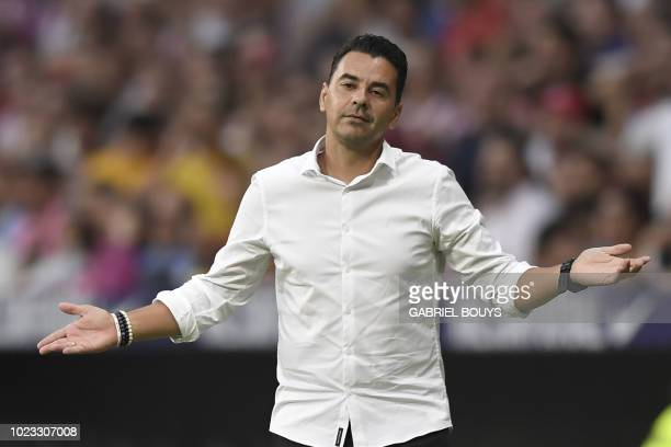 Rayo Vallecano's Spanish coach Michel gestures during the Spanish league football match between Club Atletico de Madrid and Rayo Vallecano at the...