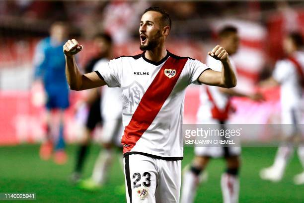 Rayo Vallecano's Spanish defender Alex Galvez celebrates at the end of the Spanish League football match between Rayo Vallecano and Real Madrid at...