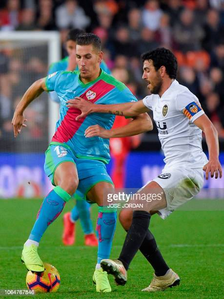 Rayo Vallecano's Spanish forward Alexander Alegria challenges Valencia's Spanish midfielder Dani Parejo during the Spanish league football match...