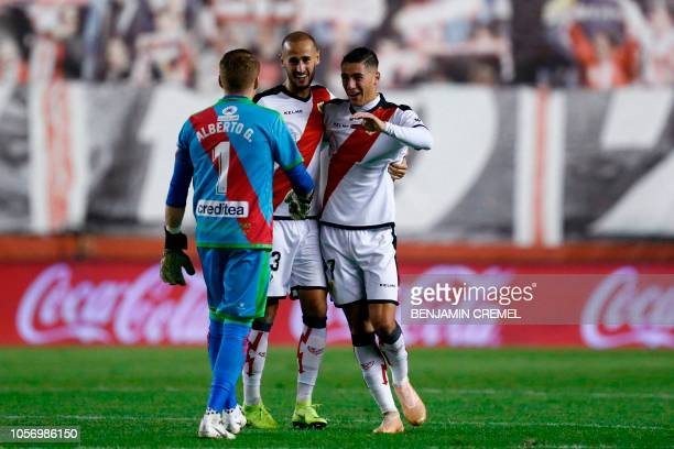 Rayo Vallecano's Spanish goalkeeper Alberto Garcia Rayo Vallecano's Spanish defender Alex Galvez and Rayo Vallecano's Spanish defender Alex Moreno...