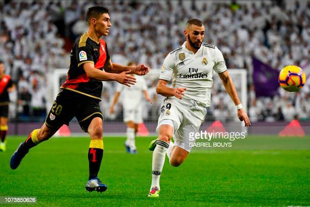 Rayo Vallecano's Uruguayan defender Emiliano Velazquez vies with Real Madrid's French forward Karim Benzema during the Spanish League football match...