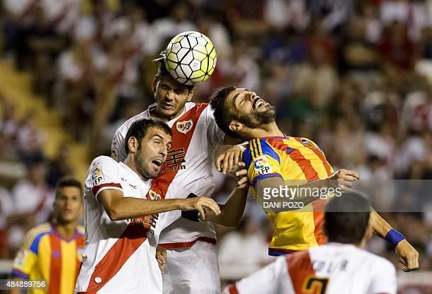 Rayo's Portuguese defender Ze Castro vies with Valencia's forward Alvaro Negredo during the Spanish league football match Rayo Vallecano de Madrid vs...