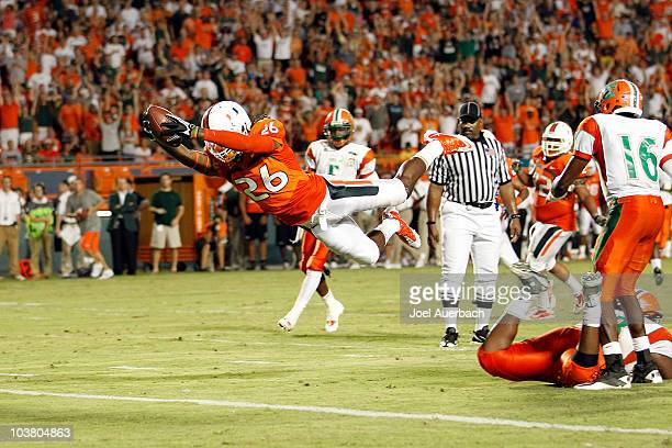 RayRay Armstrong of the Miami Hurricanes dives into the end zone for a touchdown after intercepting a pass by Martin Ukpai of the Florida AM Rattlers...