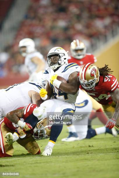 RayRay Armstrong of the San Francisco 49ers tackles Andre Williams of the Los Angeles Chargers during the game at Levi's Stadium on August 31 2017 in...