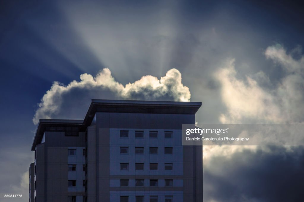 Rays, cloud and building : Stock Photo