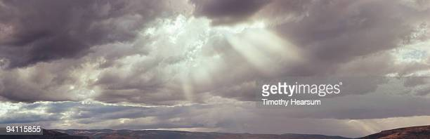 rays of light filter through storm clouds  - timothy hearsum stockfoto's en -beelden
