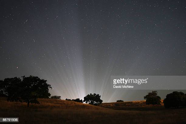 Rays of light from inside Neverland Ranch shine among the stars in the early morning darkness as fans worldwide continue to mourn the loss of singer...