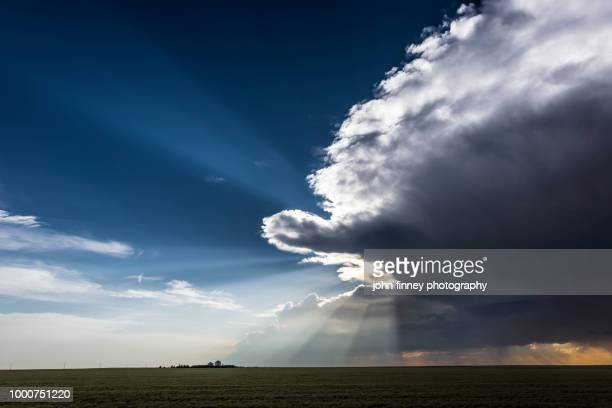 rays of storm light, colorado. usa - great plains stock pictures, royalty-free photos & images