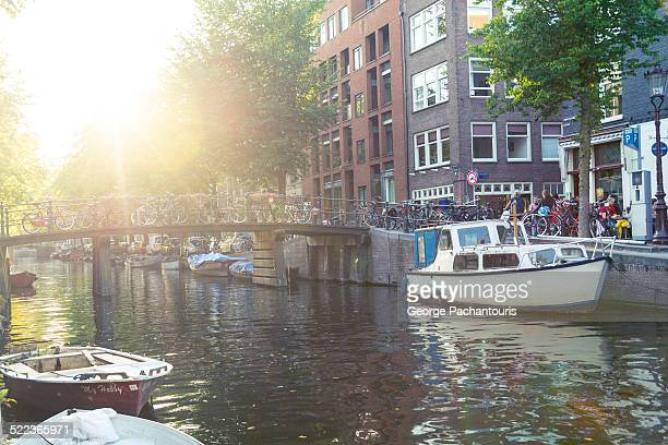 Rays of sun over a canal in Amsterdam