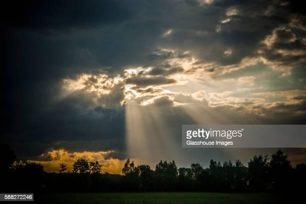 Rays of Sun Shining Through Dark Clouds