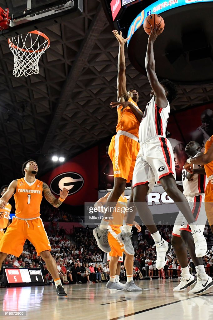 Rayshaun Hammonds #20 of the Georgia Bulldogs drives to the basket against Kyle Alexander #11 of the Tennessee Volunteers during the basketball game at Stegeman Coliseum on February 17, 2018 in Athens, Georgia.