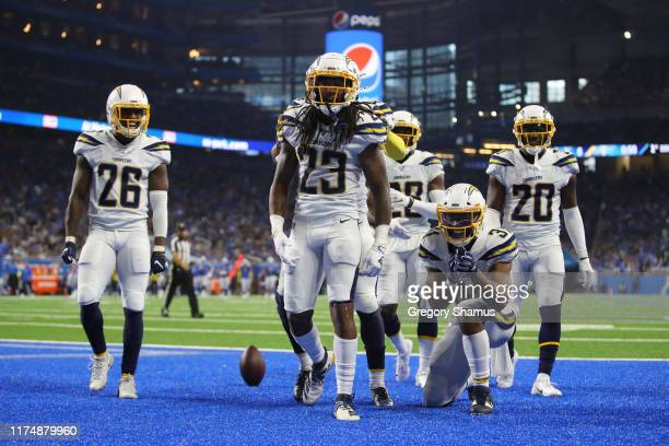 Rayshawn Jenkins of the Los Angeles Chargers celebrates a third quarter interception while playing the Detroit Lions at Ford Field on September 15,...